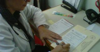 dr._eva_duarte_writing_prescriptions_for_her_patients