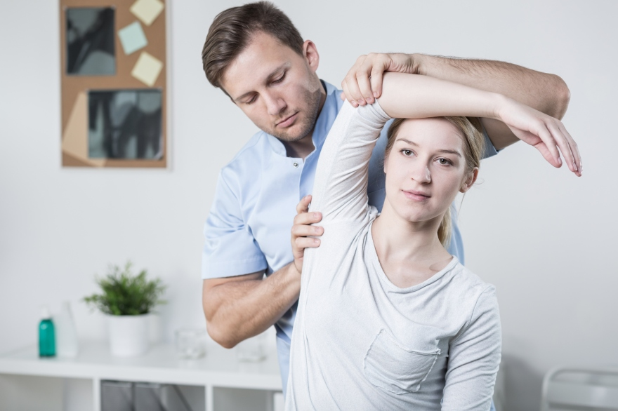 Male physiotherapist training with patient