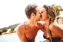 couple kissing on poolside